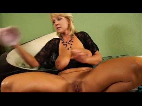 Girl plays with extra large didlo