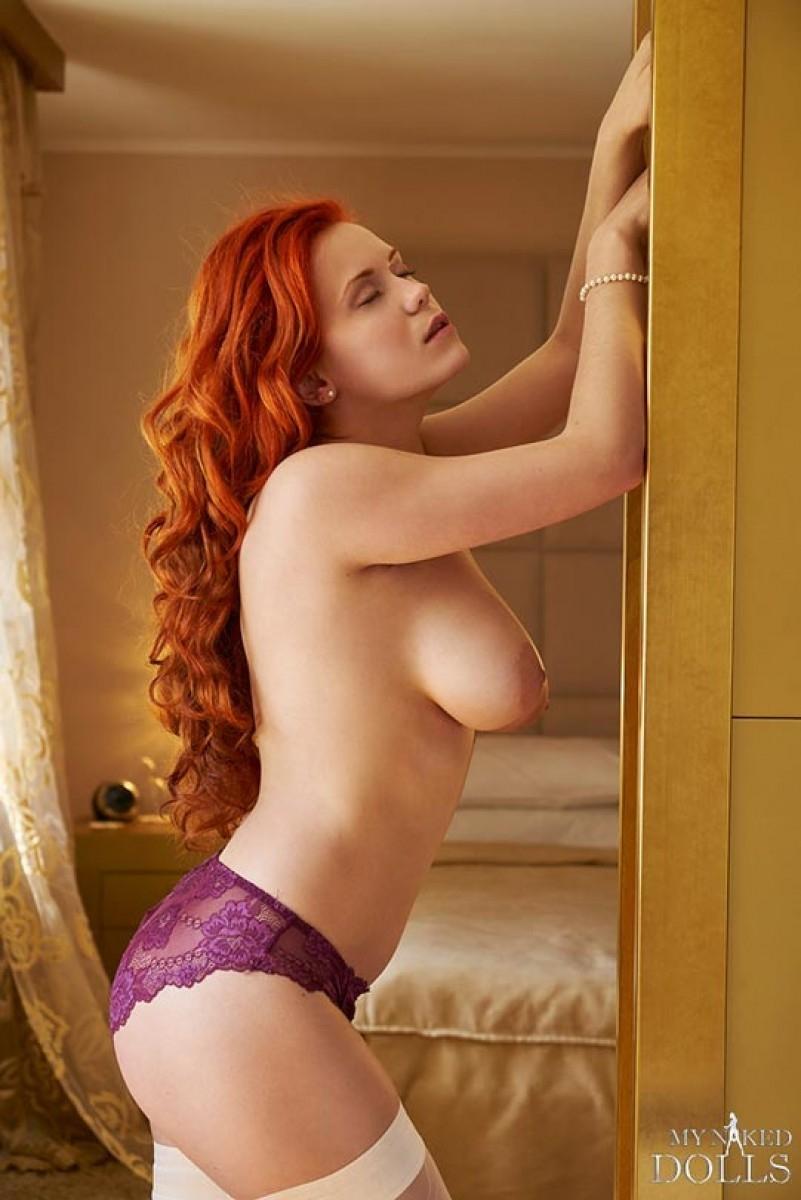 Holding big boobs redhead nude
