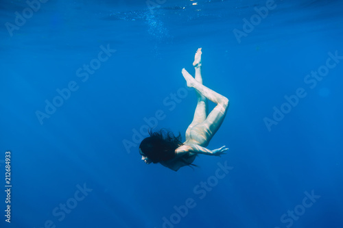 Nude underwater scuba diving