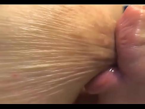 Close up breast boob oil