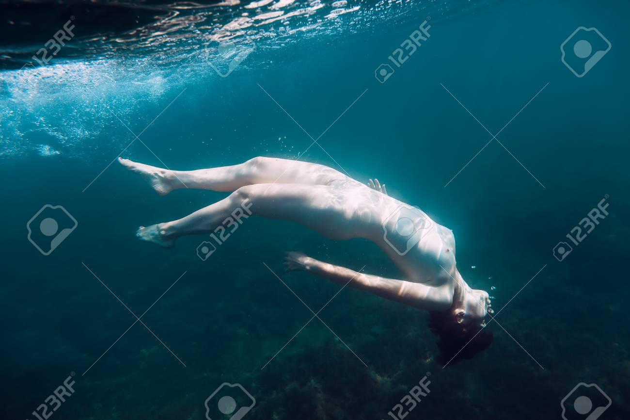 Girl nude underwater scuba diving