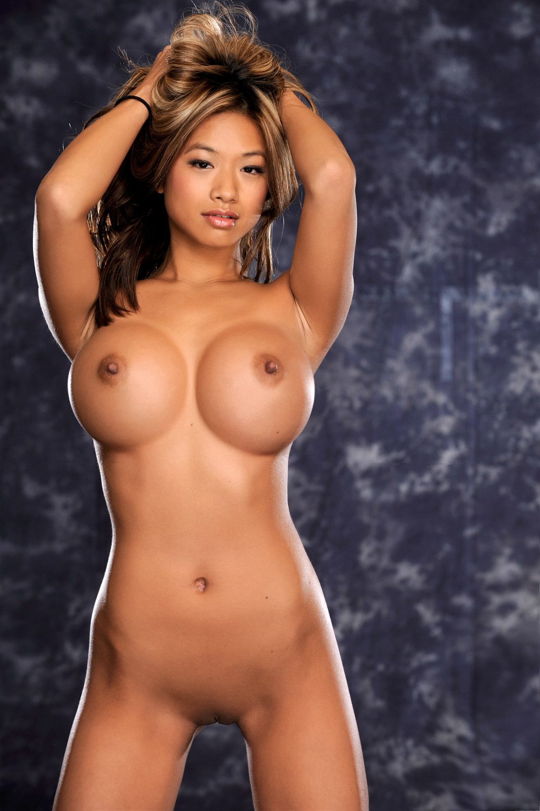 Perfect round big fake boobs photos