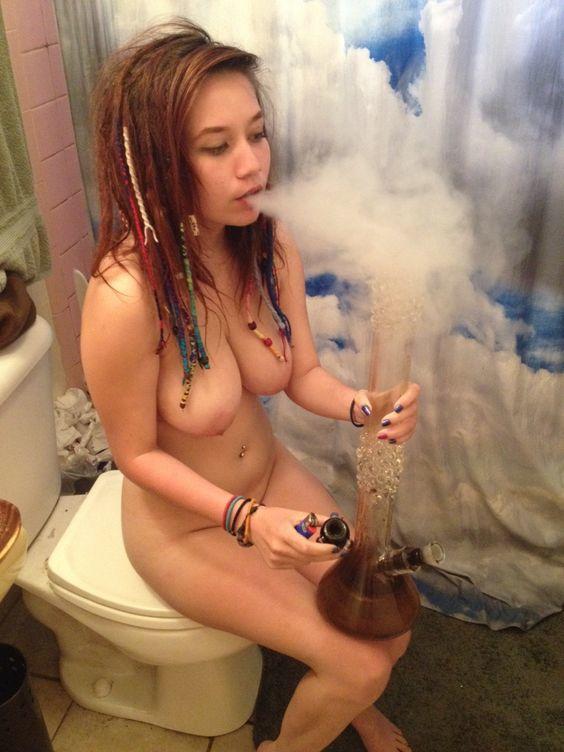 Naked girl smoking bong