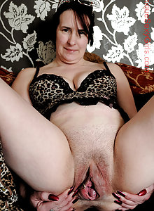 Stretching her pussy lips mature naked