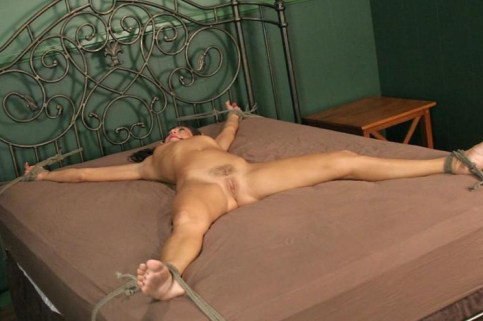 Woman chained spread eagle