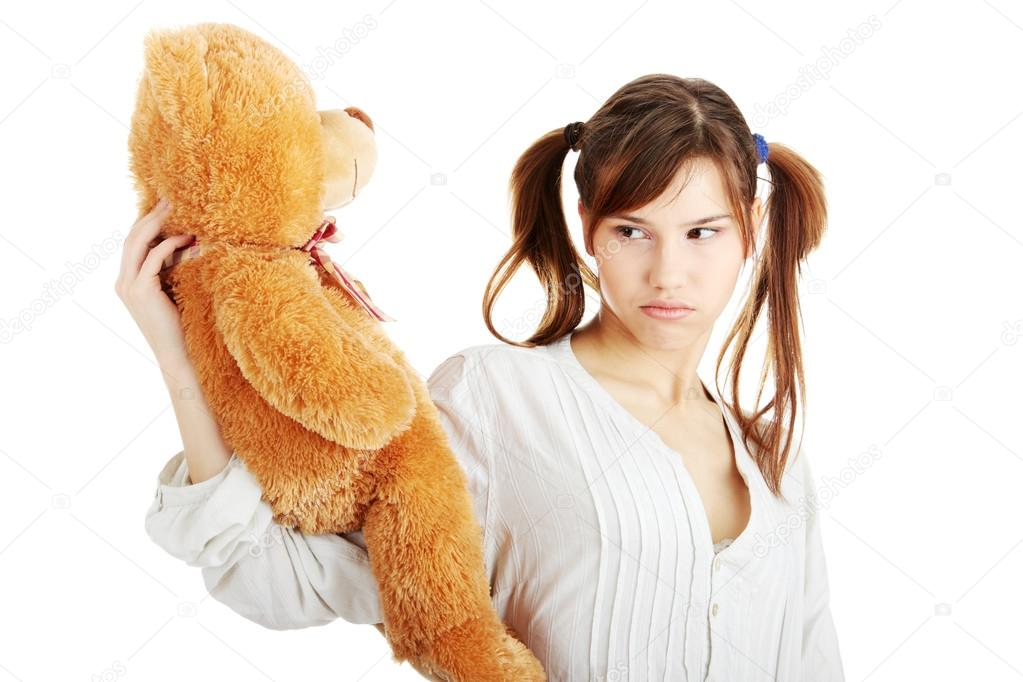 Teen with teddy bear
