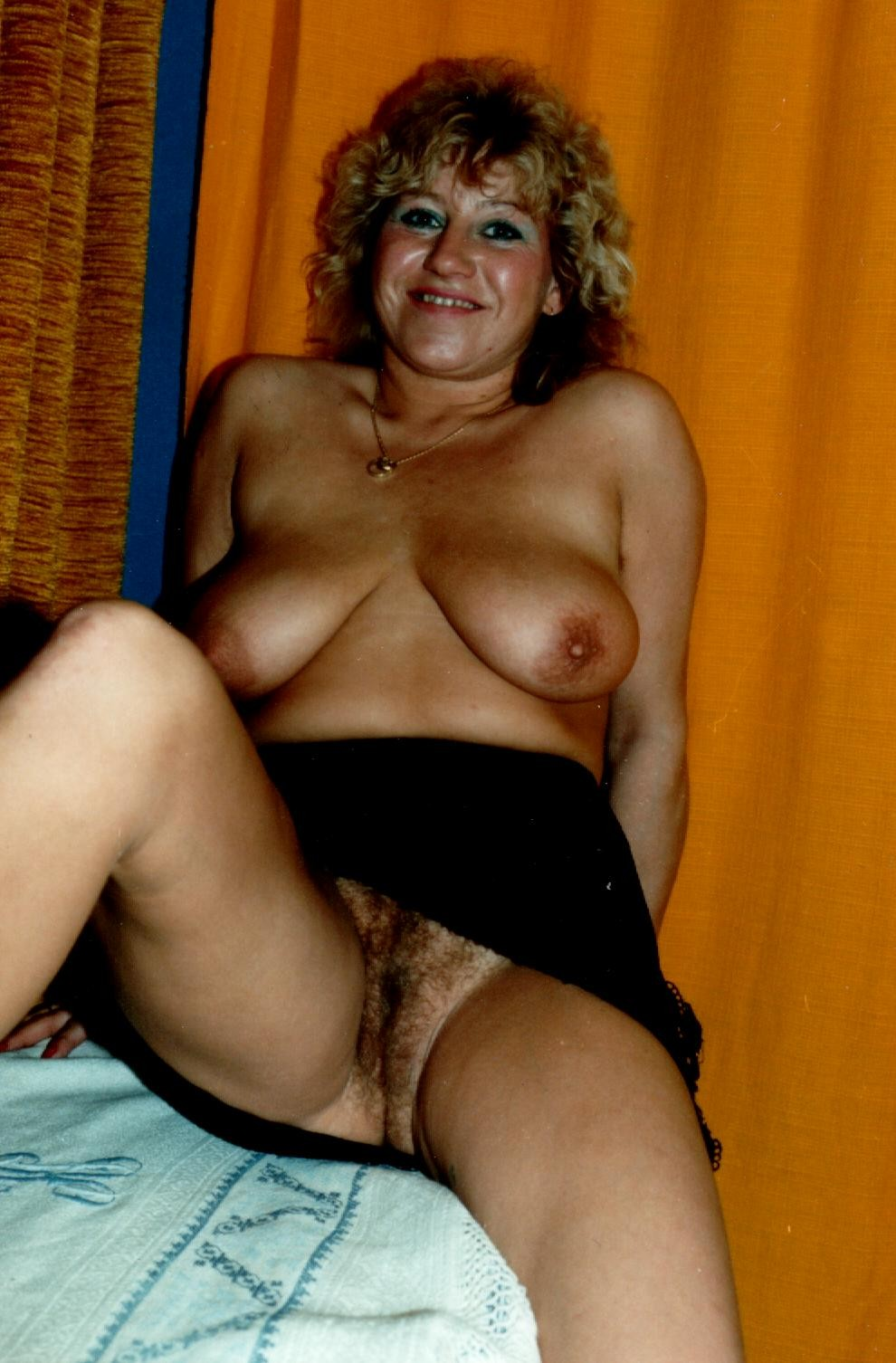 Very hairy mature lady spreads her pussy