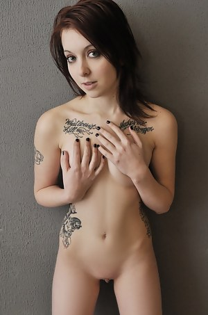 Cute nude girls with tattoos