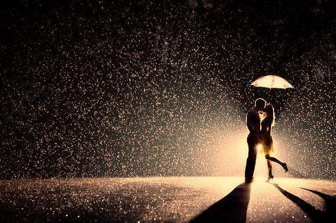 Girl boy kissing in rain