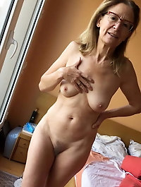 Nude mature women spreading legs