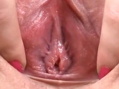 Wide open mature pussy close up