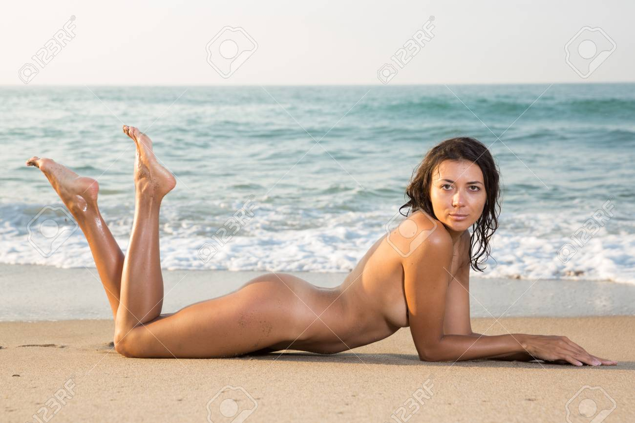 Sexy nude girl on beach