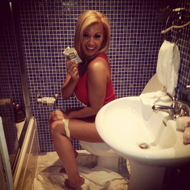 Girls pissing on toilet panties down
