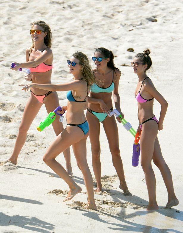 Teen girls strip swimsuits