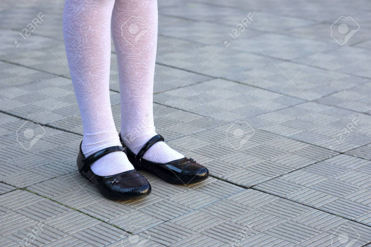 White tights black shoes