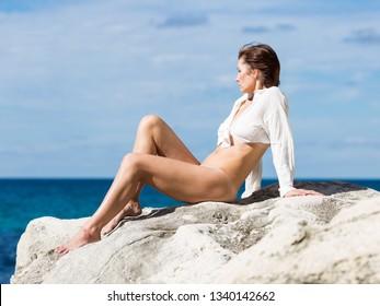 Women nude sun bathing