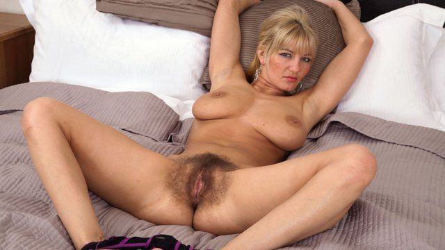 Hairy pussy blonde spreads her legs
